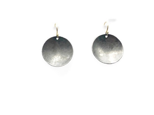Sterling silver circle earrings with an 18K gold wire.
