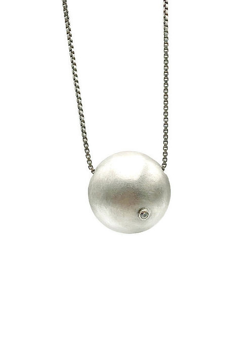 Hollow sterling silver ball necklace featuring a white topaz accent.