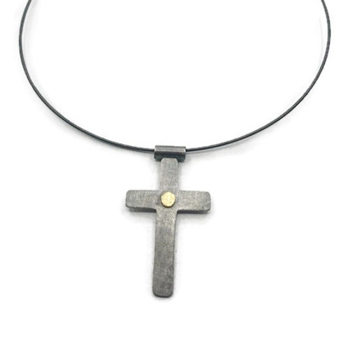 Gold and silver cross pendant.