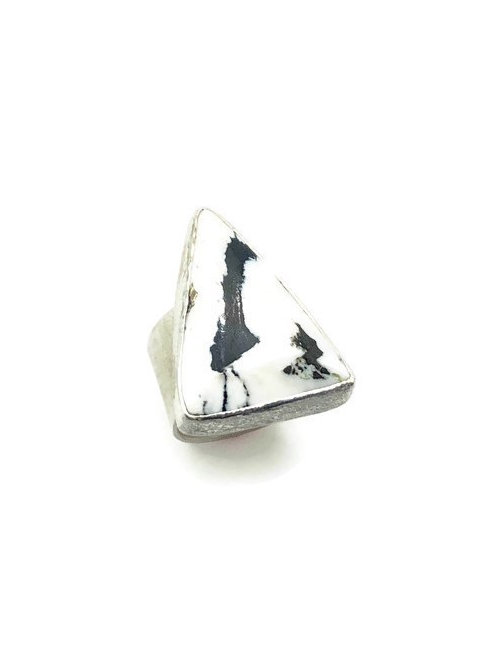 This ring features faceted white buffalo turquoise set in sterling silver.