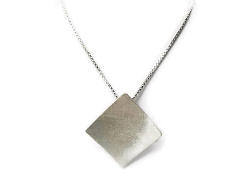 A bold square necklace set in sterling silver.