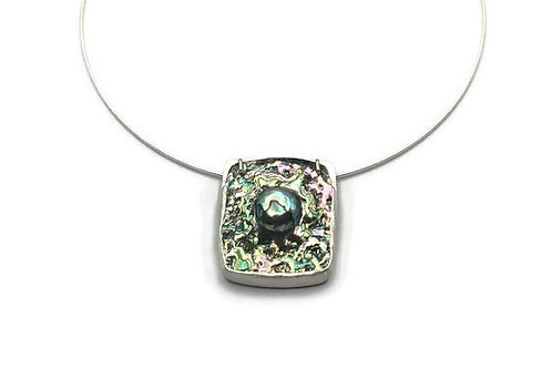 A black abalone and Mabe pearl necklace set in sterling silver.