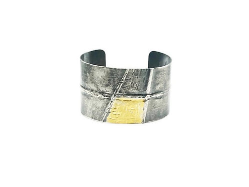Silver and gold fold forming cuff bracelet.