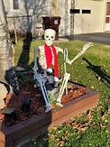 SkeletonWavingSeatedwithCandyCAne.jpg