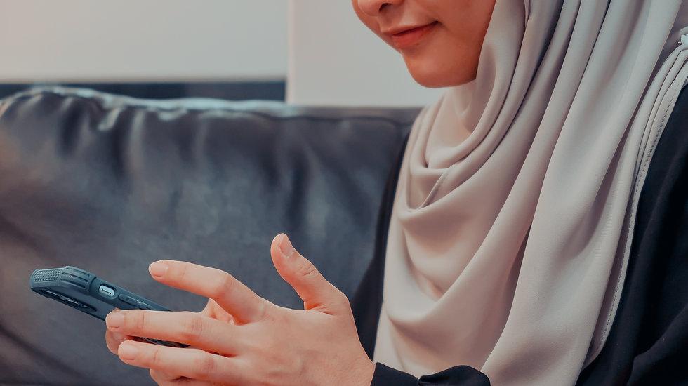 A women holding a phone