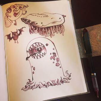 sketchbook page, pen, marker, monster, tentacles, bats, elephants, axolotl