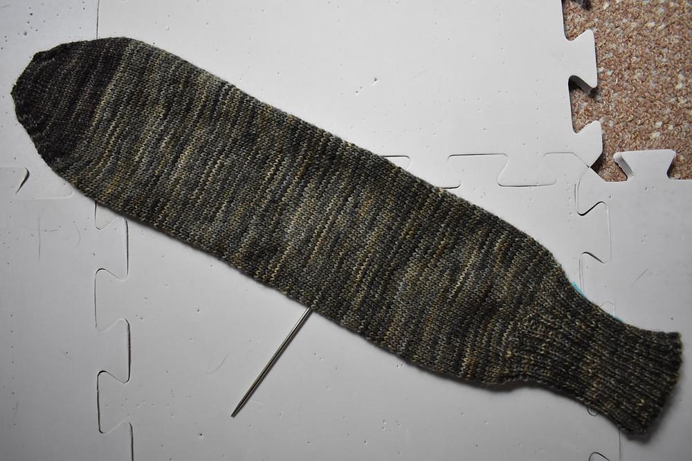 Brown variegated sock on blocking mats