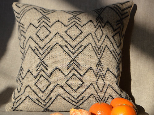 Black and neutral symbols cushion