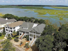 The ideal location! Aerial view of the home with  Hole #12 in the front  and the Marsh in the back. Sunsets are AMAZING here!