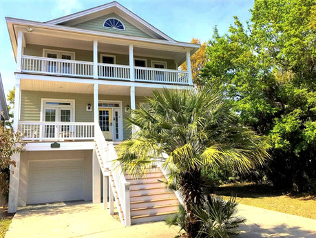 The house has 4 porches - 2 on the front and 2 screened porches on the back for enjoying the views of the Marsh.