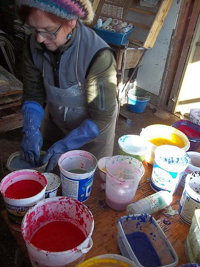 Preparing the pigmented cotton rag pots.