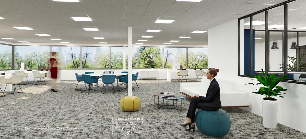 Un open space avec bureaux et espace de réunion ouvert, et vue sur la cuisine