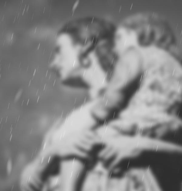 svartvit bild på moder som bär dotter