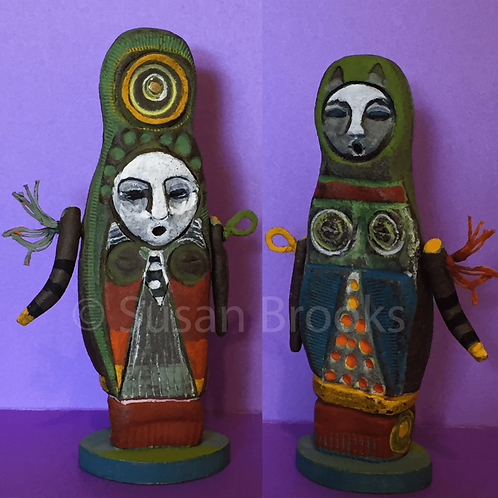 2 sided Ceramic body, moveable arms, linen embellishments. Highly decorated on both sides, with abstracted Owl on the outfits