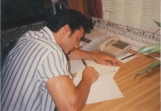 Niko inking Camel book copy.jpg