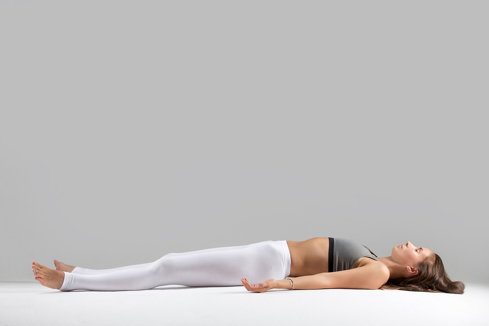 postura yoga per il mal di schiena