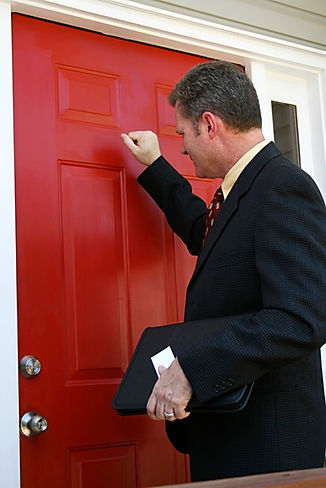 Process Server Knocking on a red door