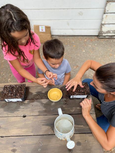 Martinez Family Planting Seeds (Image: getstarted)