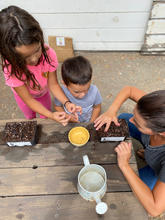 Martinez Family Planting Seeds (Image: getstarted)