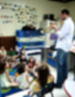A Soyulla teacher introduces a kindergarten class to the sound of the trumpet and mute