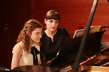 A piano teacher guides her student in a private lesson at a school on the Upper East Side UES