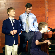 Students and their teacher rehearse singing and playing piano before the Soyulla recital