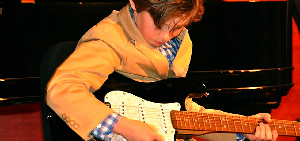 A student plays pieces he learned in lessons on the Soyulla showcase recital