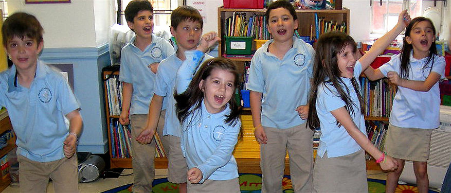 Kids learn through play, dancing like different animals at a private UES school in Manhattan