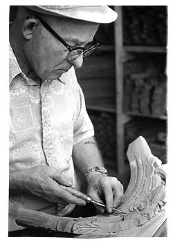 Kimball employee hand-carving a wooden chair