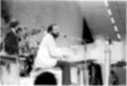 Man playing a Kimball piano