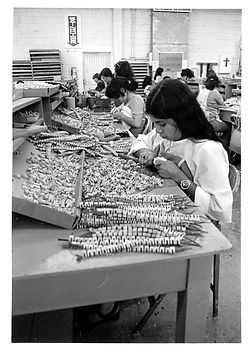 Kimball employees assembling piano keys