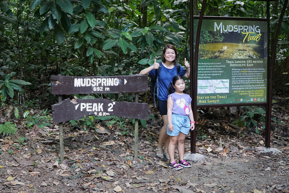 Mother and Daughter at Mudspring Signage of Mount Makiling