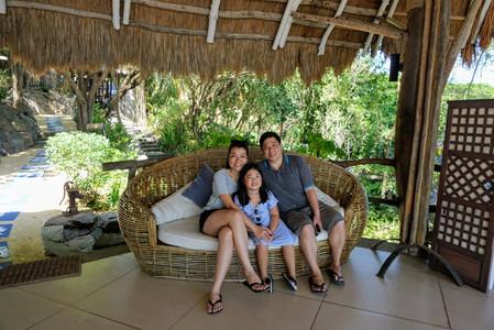 Family pose at nature resort entrance Vivere Azure