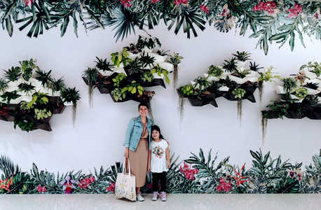 Mommy and daughter at Singapore Changi Airport