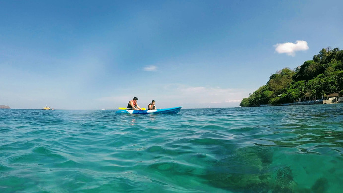 Father and daughter kayaking at Sea