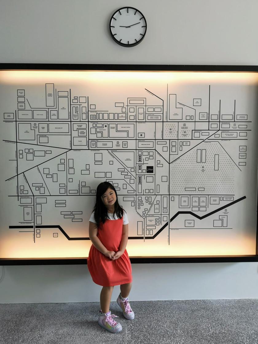 Little girl at Lloyd's Inn Singapore entrance lobby