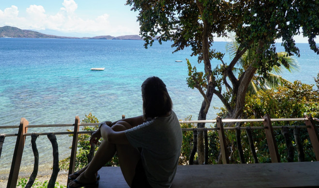 Woman gazing at the sea