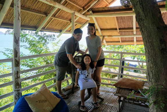 Family on top of Tree House with Sea View