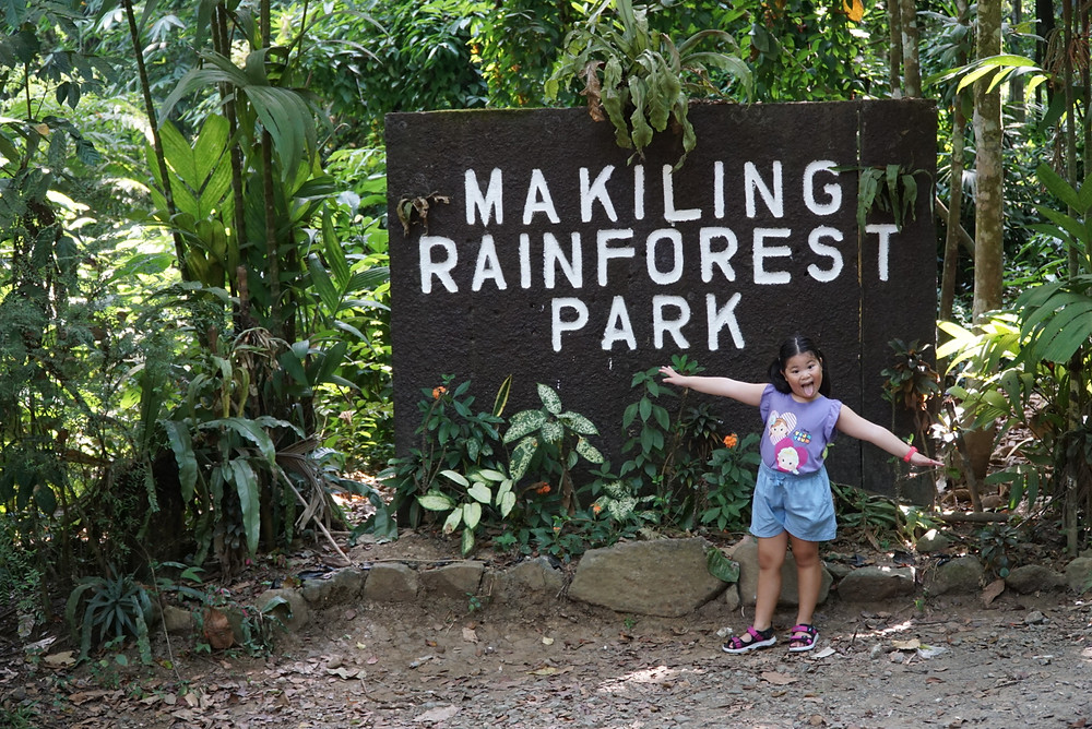 Happy Girl of Aguiventures at Mount Makiling Rainforest Park Signage