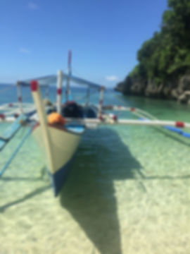 Aguiventure Family Travel Blog Romblon Boat on Clear Wates