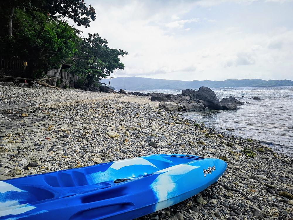 Kayak on stone beach