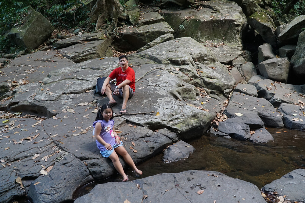 Father and daughter resting at Flat Rocks Mount Makiling