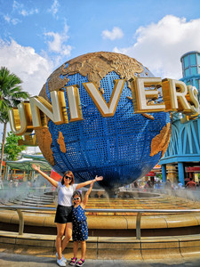 Mommy and daughter Aguiventures at famous Universal Studios Singapore globe entrance