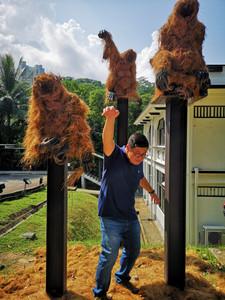 Man with Orangutans at Disini Art Exhibit at Gillman Barracks SIngapore