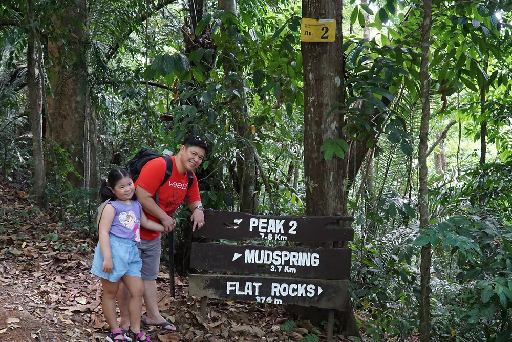 Father and daughter at Flat Rocks Mount Makiling signage