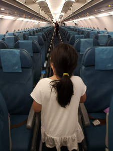 Little girl on board Philippine Airlines empty airplane