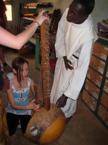 Getting a tour of where the monks make koras (African harps) by hand