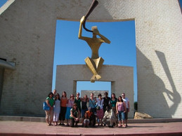 The doorway to the new millenium monument with the group of students and program coordinators
