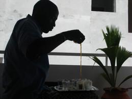 Waly preparing attaya (sweetened black tea)