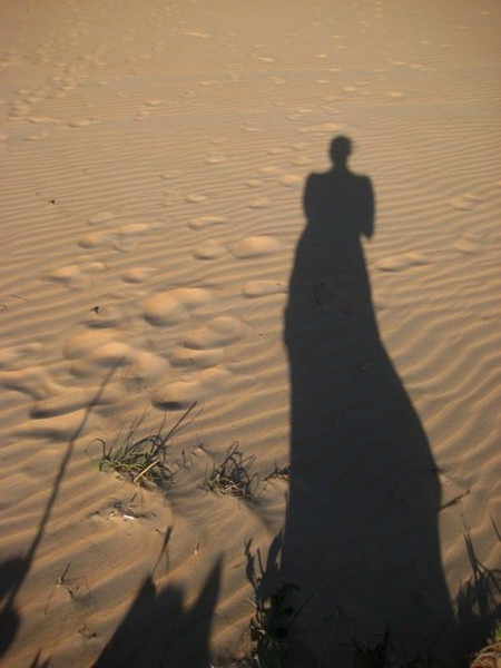 Playing with shadows in the desert near Lac Rose
